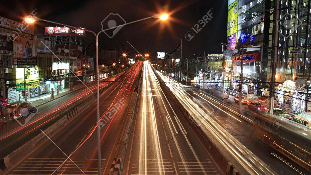 NONTHABURI-DEC 16  Light trails on the bridge and Ngamwongwan street near Shopping center at night on December 16, 2012 in Nonthaburi province, Thailand   Stock Photo - 17679082