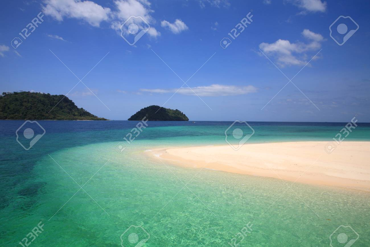 Beautiful Andaman crystal sea at shore on Khai island against blue sky in Satun province, Thailand Stock Photo - 18047564