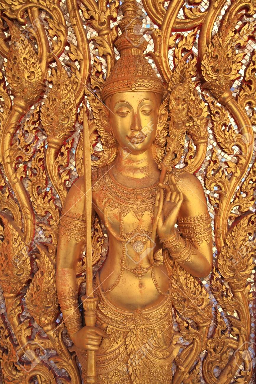 Golden guardian god with sword decorated at Wat Tha Sung in Uthai Thani, Thailand Stock Photo - 21608342