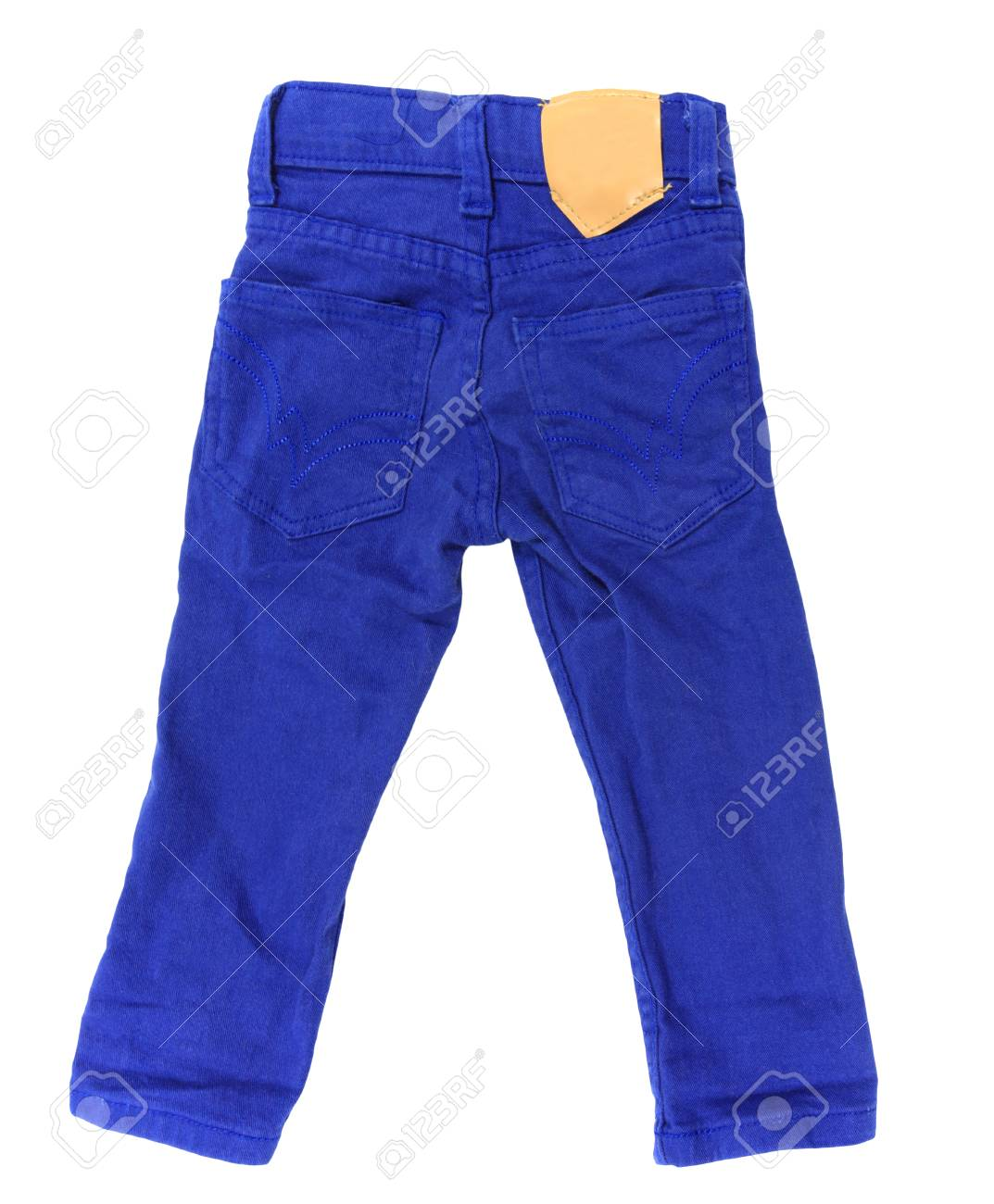 mejor sitio web 384a2 abccc Pantalones vaqueros azul del niño con etiqueta en blanco aislado más de  fondo blanco (Niños