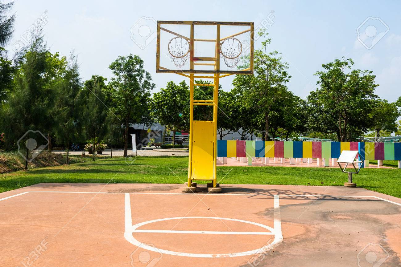 outdoor basketball court with two hoops weird sport style stock photo