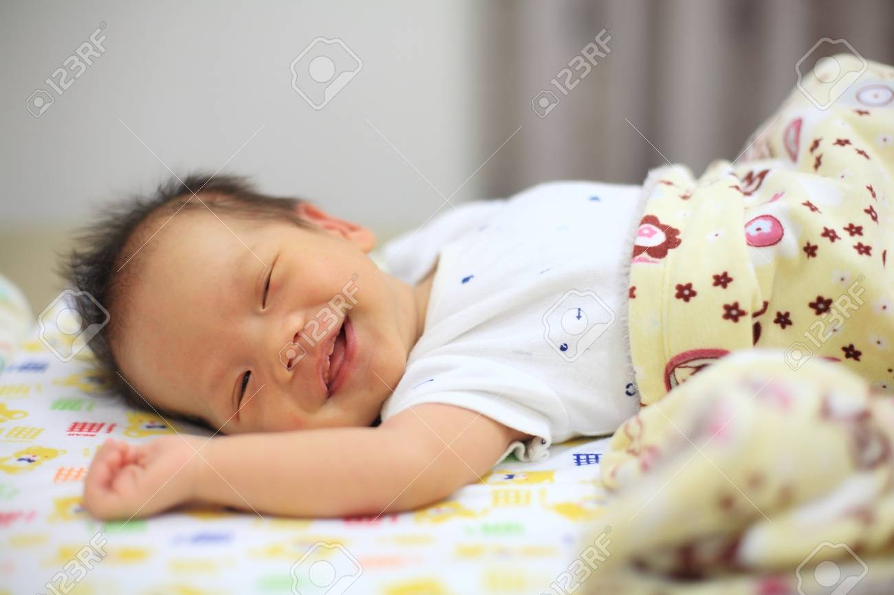 Newborn Baby Boy Sleep With Cute Smile 1 Month Old Stock Photo