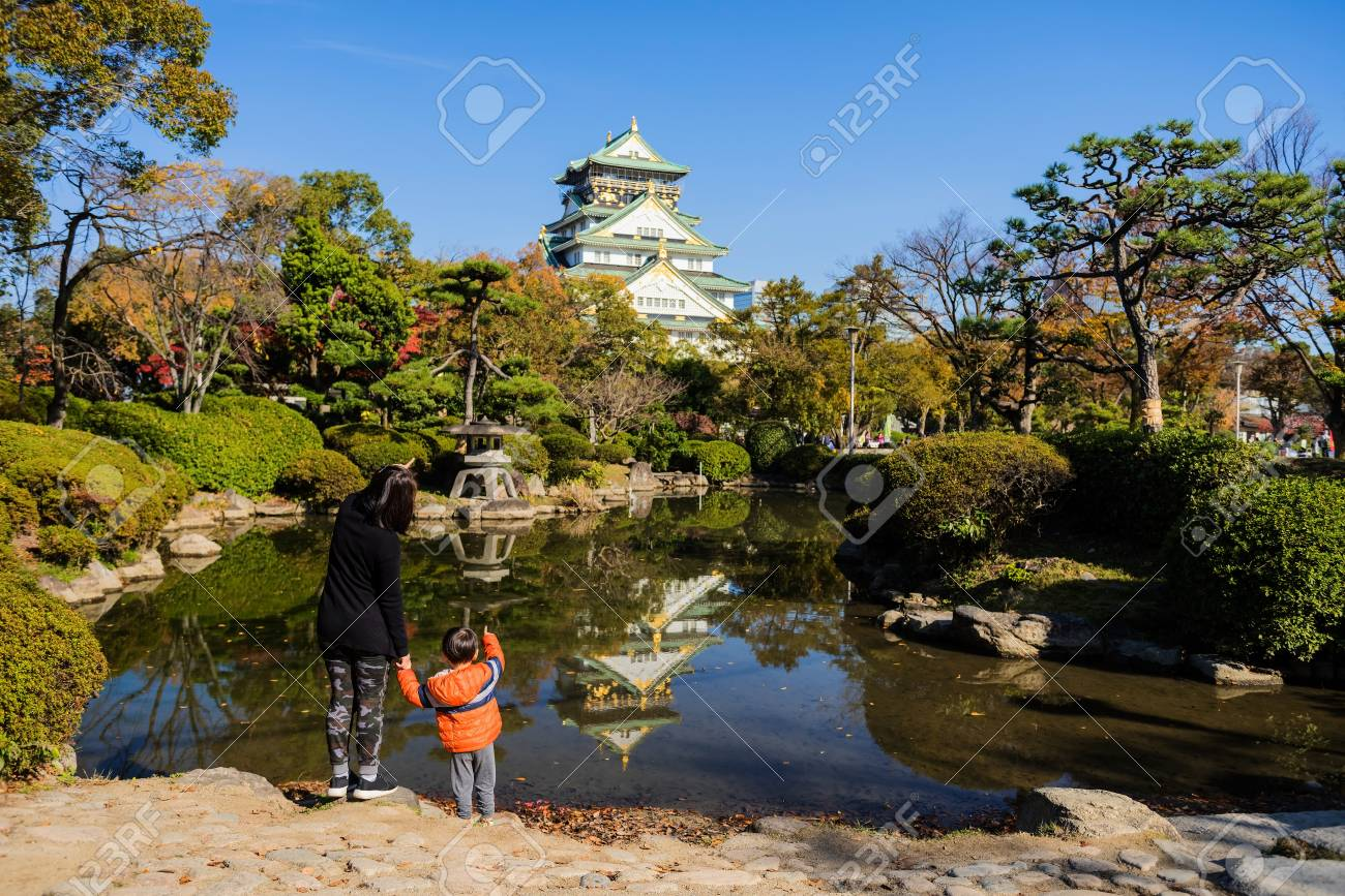 Mom And Son Visit Osaka Castle At Autumn, Japan Stock Photo, Picture ...
