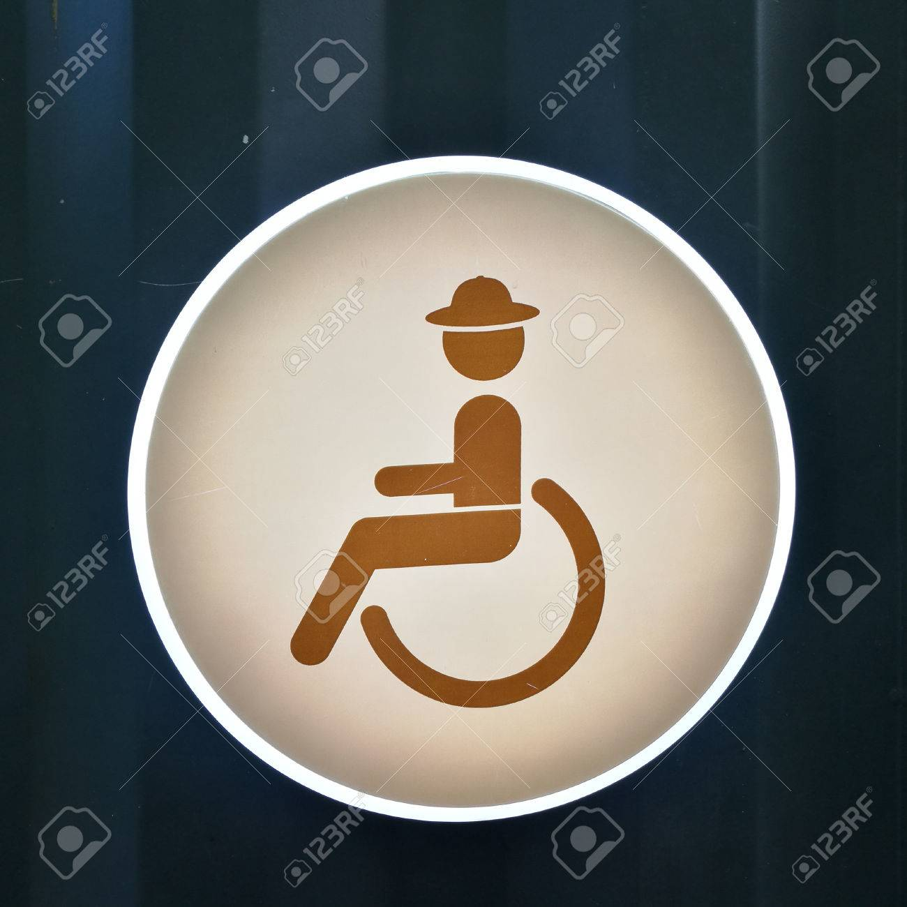 Handicap Toilet Sign On Blue Zinc Metal Wall Stock Photo