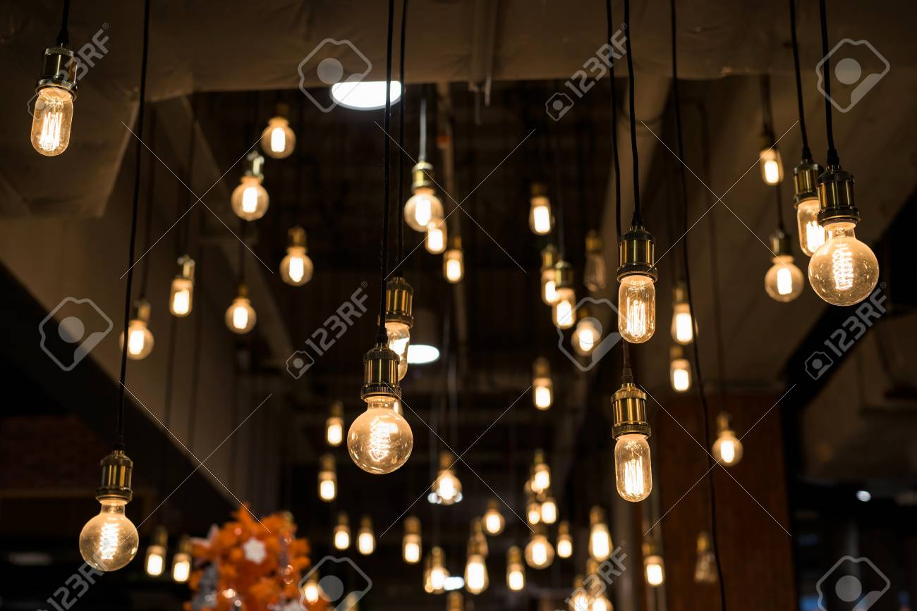Many Light Bulbs Hanging By Long Wire. Interior Decoration Stock Photo    82191467