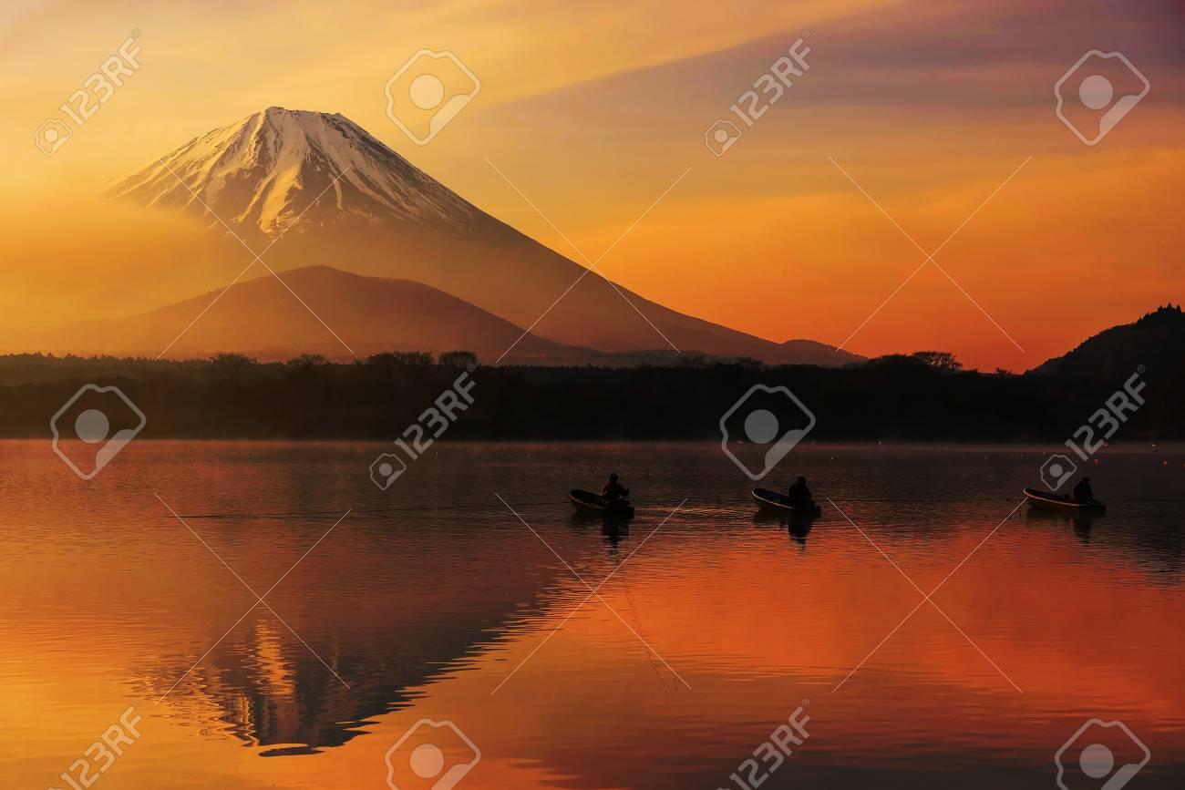 Mt Fuji Or Fujisan With Silhouette Three Fishing People On Boats
