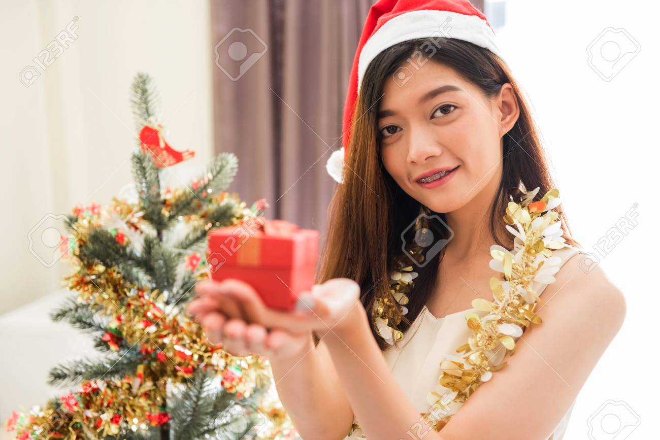 Happy Beautiful Asian Woman, 20 To 30 Years Old, With Santa Claus ...