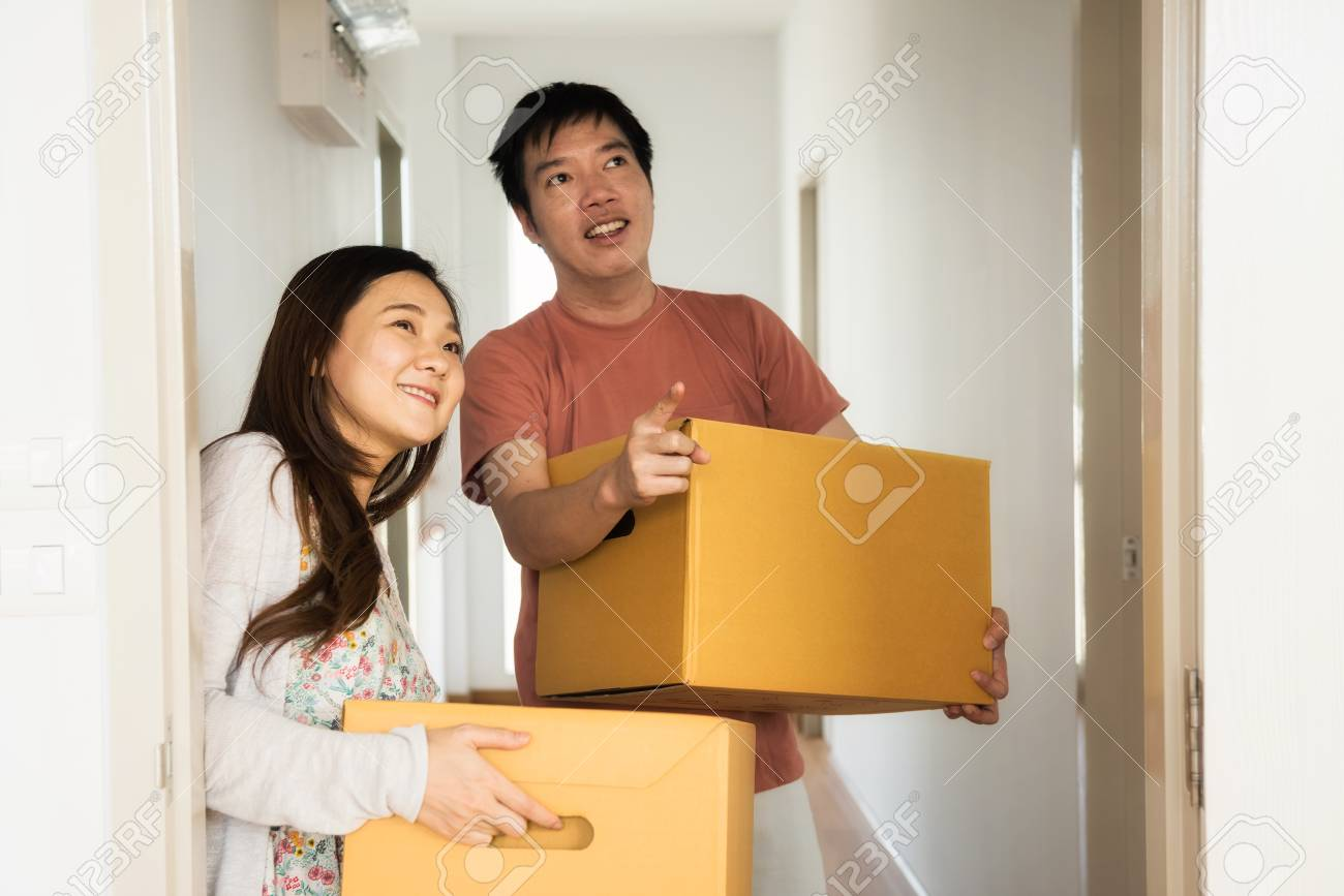 Smile Asian Couple Carry Moving Boxes Into Master Bedroom Of Stock Photo Picture And Royalty Free Image Image 92230247