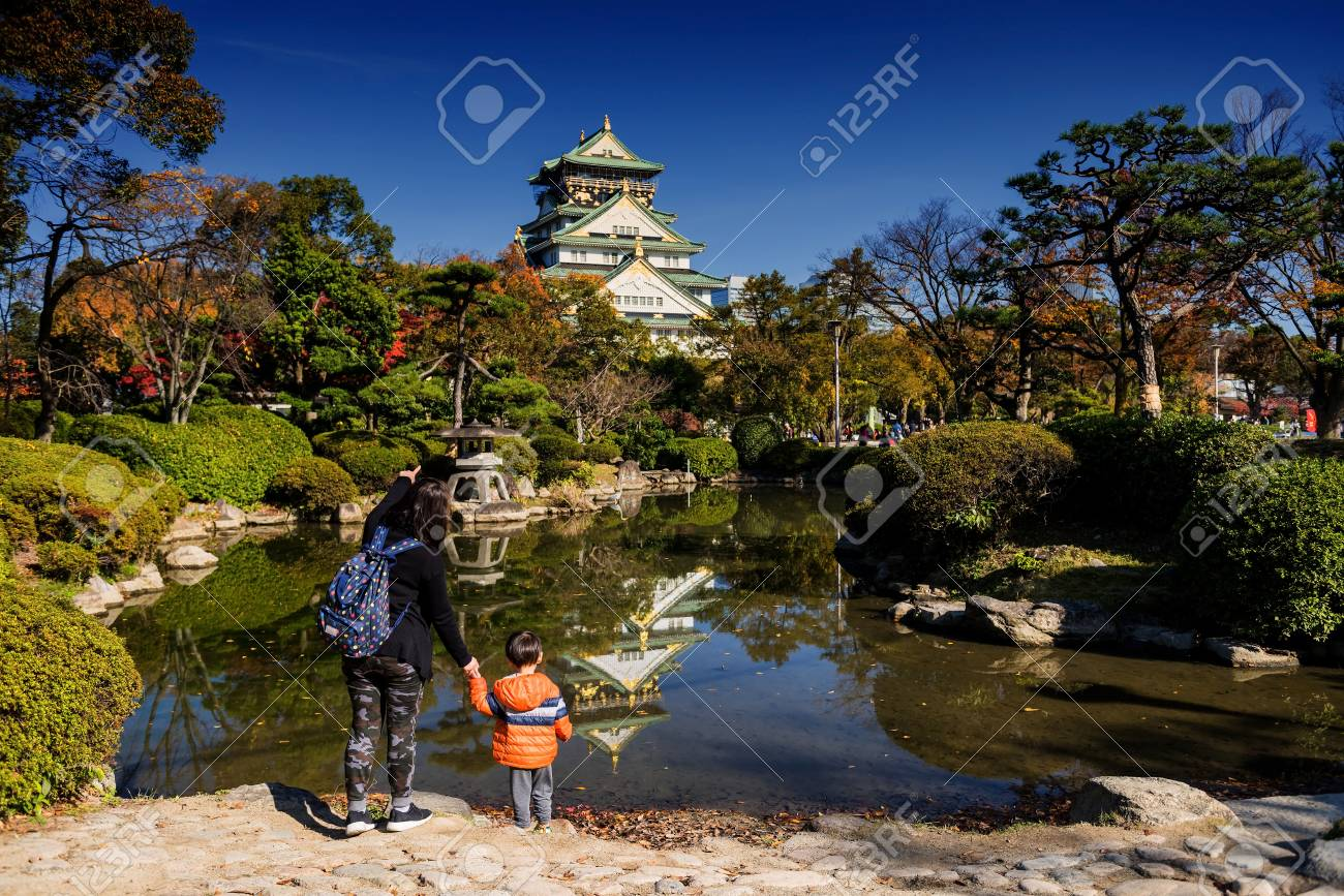 Mother Pointing Her Finger To Osaka Castle With Fall Colors And ...