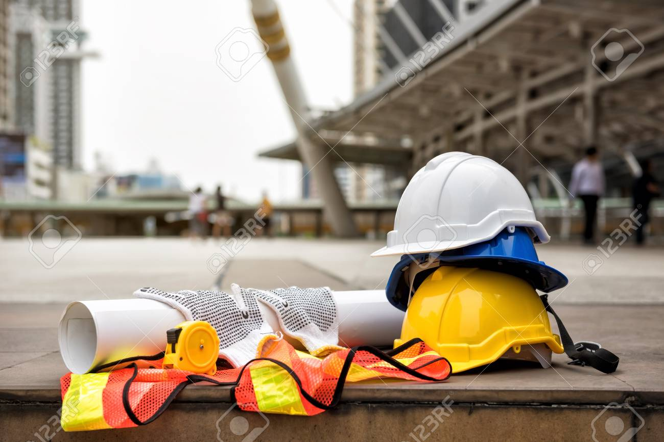 Safety helmet hats blueprint paper project measure tape gloves safety helmet hats blueprint paper project measure tape gloves and worker dress malvernweather Choice Image
