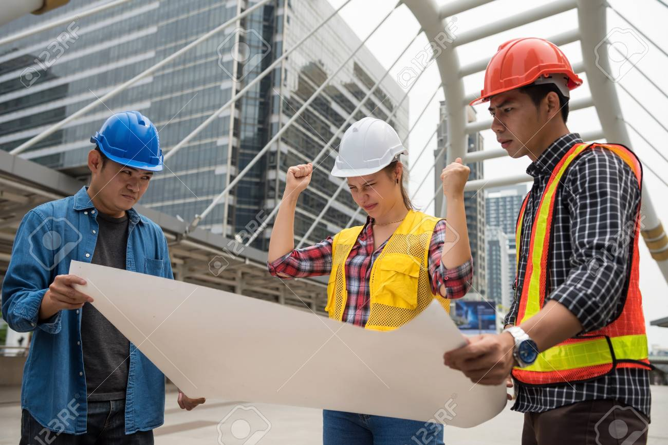 Angry and stress american woman boss look at blueprint paper stock angry and stress american woman boss look at blueprint paper plan and blame asian engineering men malvernweather Image collections