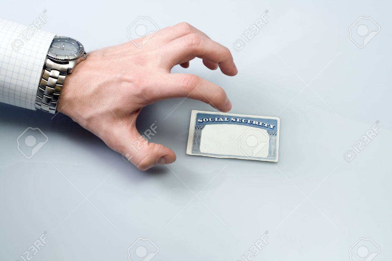 Hand is stealing Social Security Card over white background. Stock Photo - 6676791