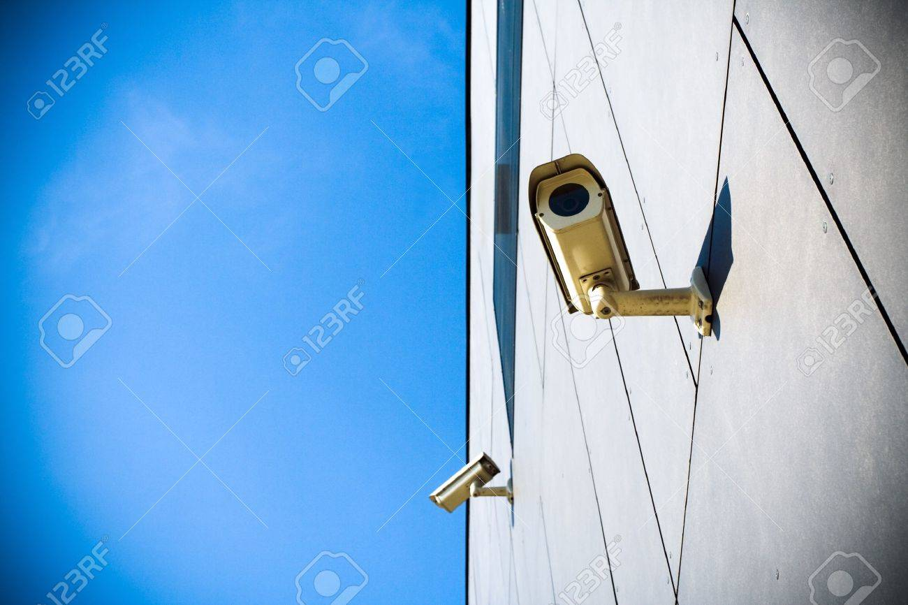 Security camera on building and blue sky Stock Photo - 7037341