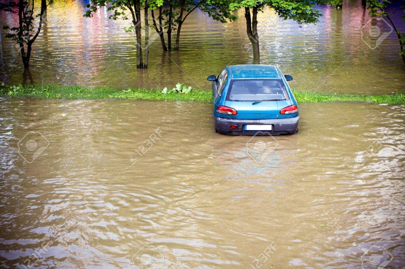 Flood insurance need before, flooded car on parking lot Stock Photo - 7712461