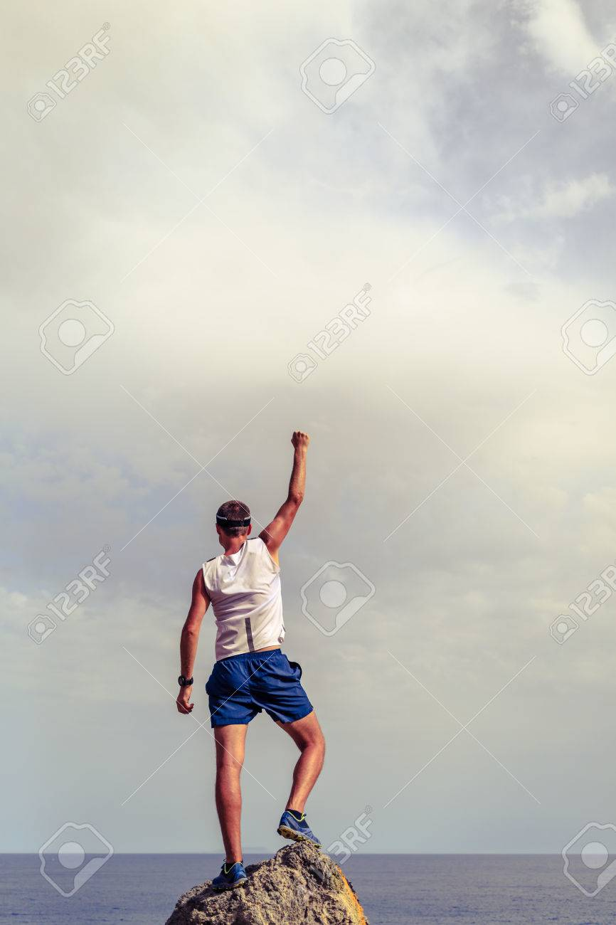 success achievement running or hiking accomplishment business stock photo success achievement running or hiking accomplishment business concept man celebrating arms up raised outstretched trekking climbing