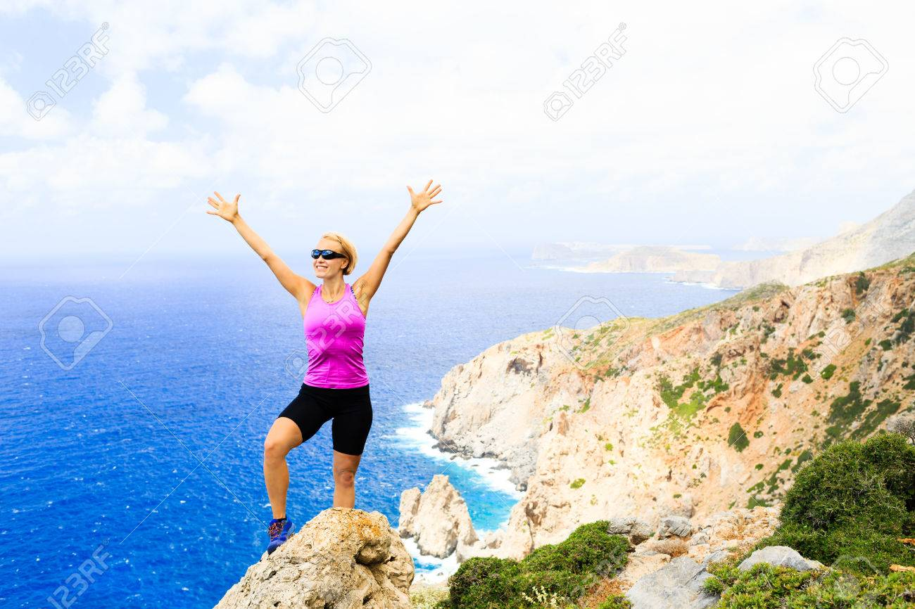success achievement climbing or hiking accomplishment concept stock photo success achievement climbing or hiking accomplishment concept w trail runner celebrating arms up raised outstretched hiking