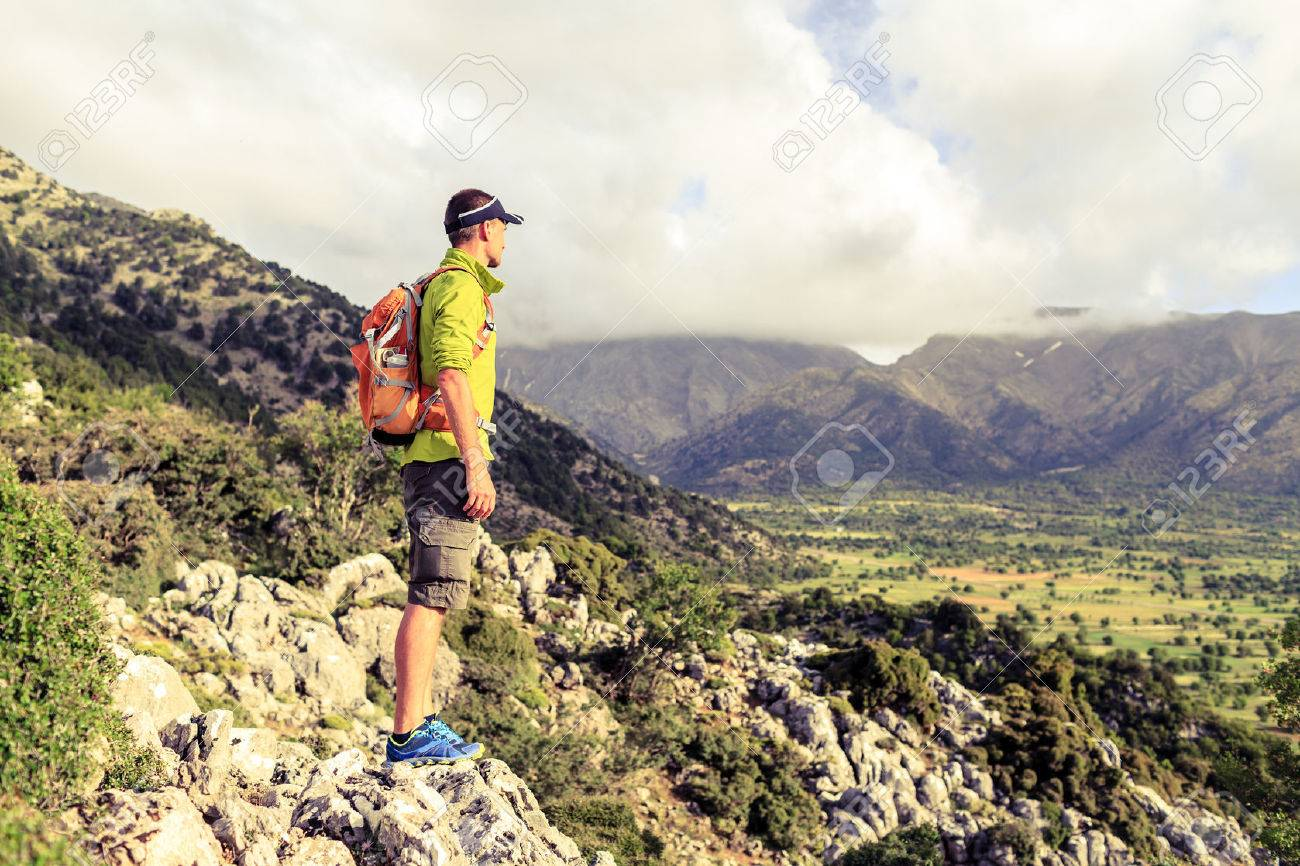Hiking man looking at beautiful mountains inspirational landscape. Hiker trekking with backpack on rocky trail footpath. Healthy fitness lifestyle outdoors concept. - 41854866