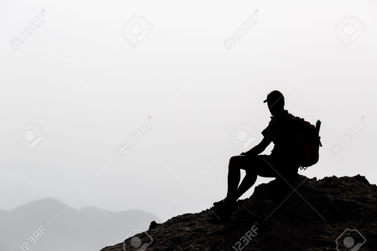 Man camping and hiking silhouette in mountains, inspiration and motivation concept. Hiker with backpack on top of rocky mountain looking at beautiful inspirational landscape. - 42152566