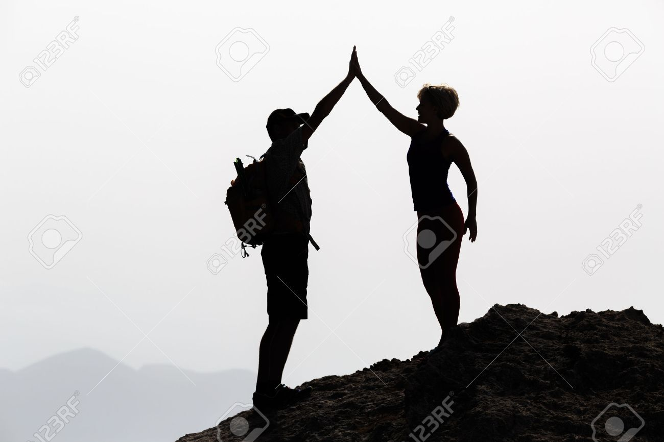 Successful couple achievement climbing or hiking, business concept with man and woman celebrating with arms up raised outstretched outdoors. Motivational and inspirationan silhouette landscape. - 42152568