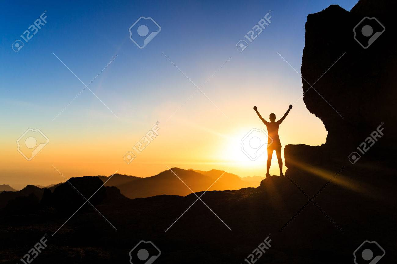 Woman successful hiking climbing silhouette in mountains, motivation and inspiration in beautiful sunset and ocean. Female hiker with arms up outstretched on mountain top looking at beautiful night sunset inspirational landscape. - 43648600