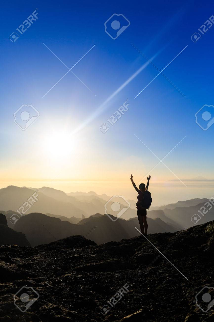 Woman successful hiking climbing silhouette in mountains, motivation and inspiration in beautiful sunset and ocean. Female hiker with arms up outstretched on mountain top looking at beautiful night sunset inspirational landscape. - 43648604