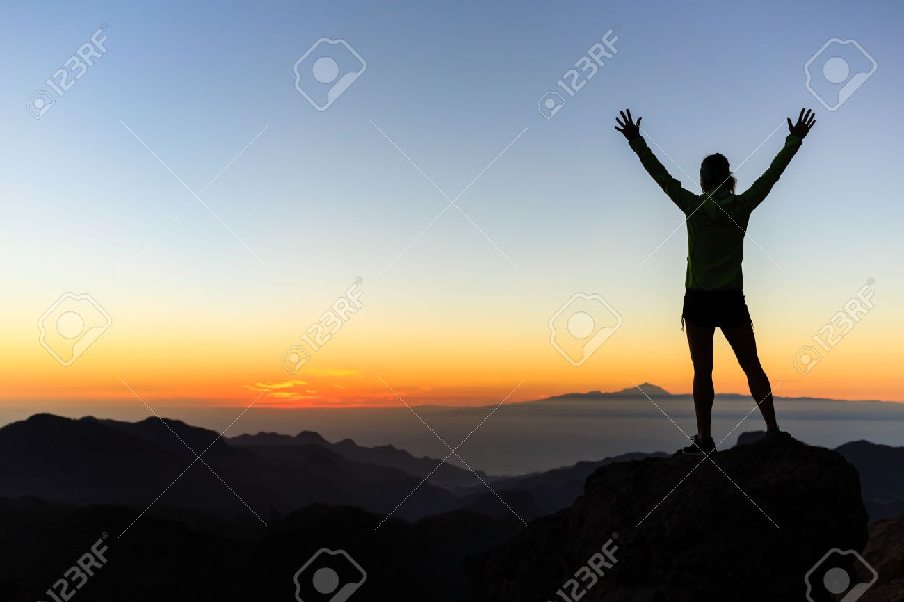 Woman successful hiking climbing silhouette in mountains, motivation and inspiration in beautiful sunset and ocean. Female hiker with arms up outstretched on mountain top looking at beautiful night sunset inspirational landscape. - 43648606