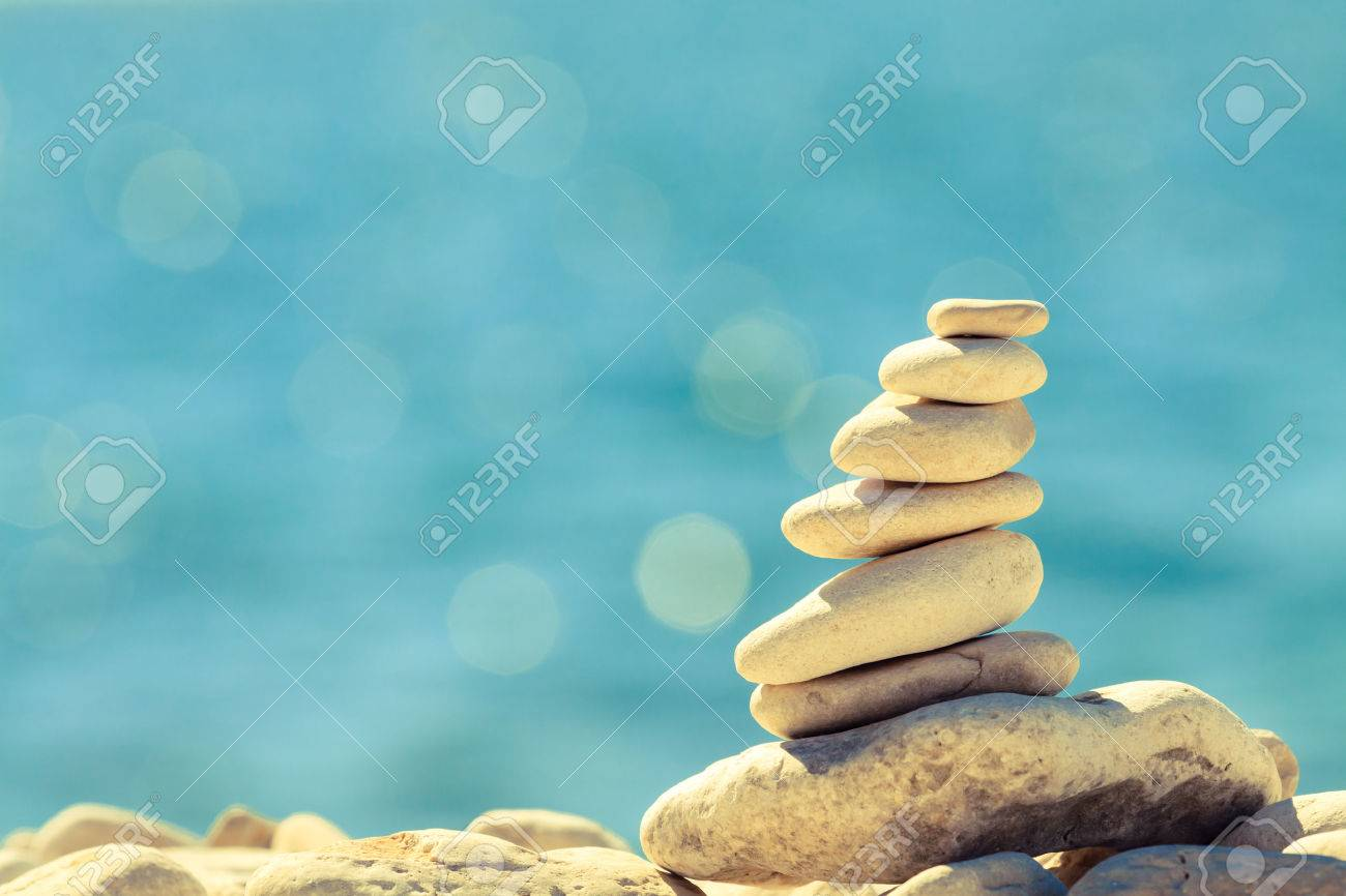 Stones balance at the vintage beach, inspirational summer landscape. Stability hierarchy stack over blue sea in Croatia. Spa or well-being, freedom and stability concept on rocks. - 44318066