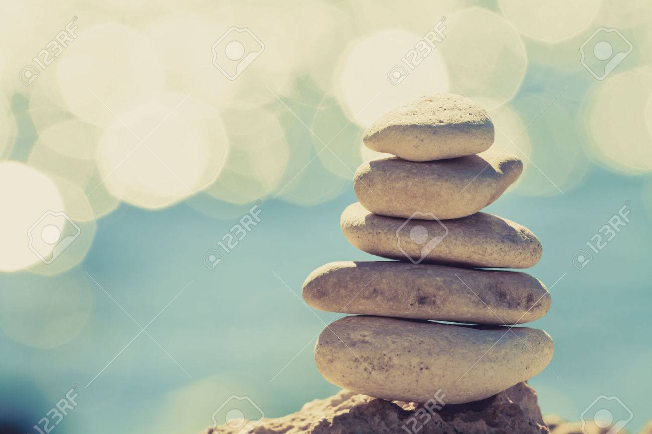 Stones balance at the vintage beach, inspirational summer landscape. Stability hierarchy stack over blue sea in Croatia. Spa or well-being, freedom and stability concept on rocks. - 44316740