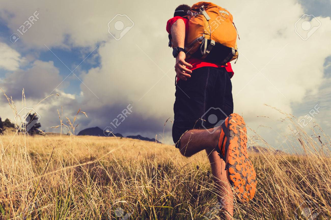 Hiking man or trail runner walking in mountains. Travel in Italy, Europe. Fitness and healthy lifestyle outdoors in fall autumn nature - 45775617