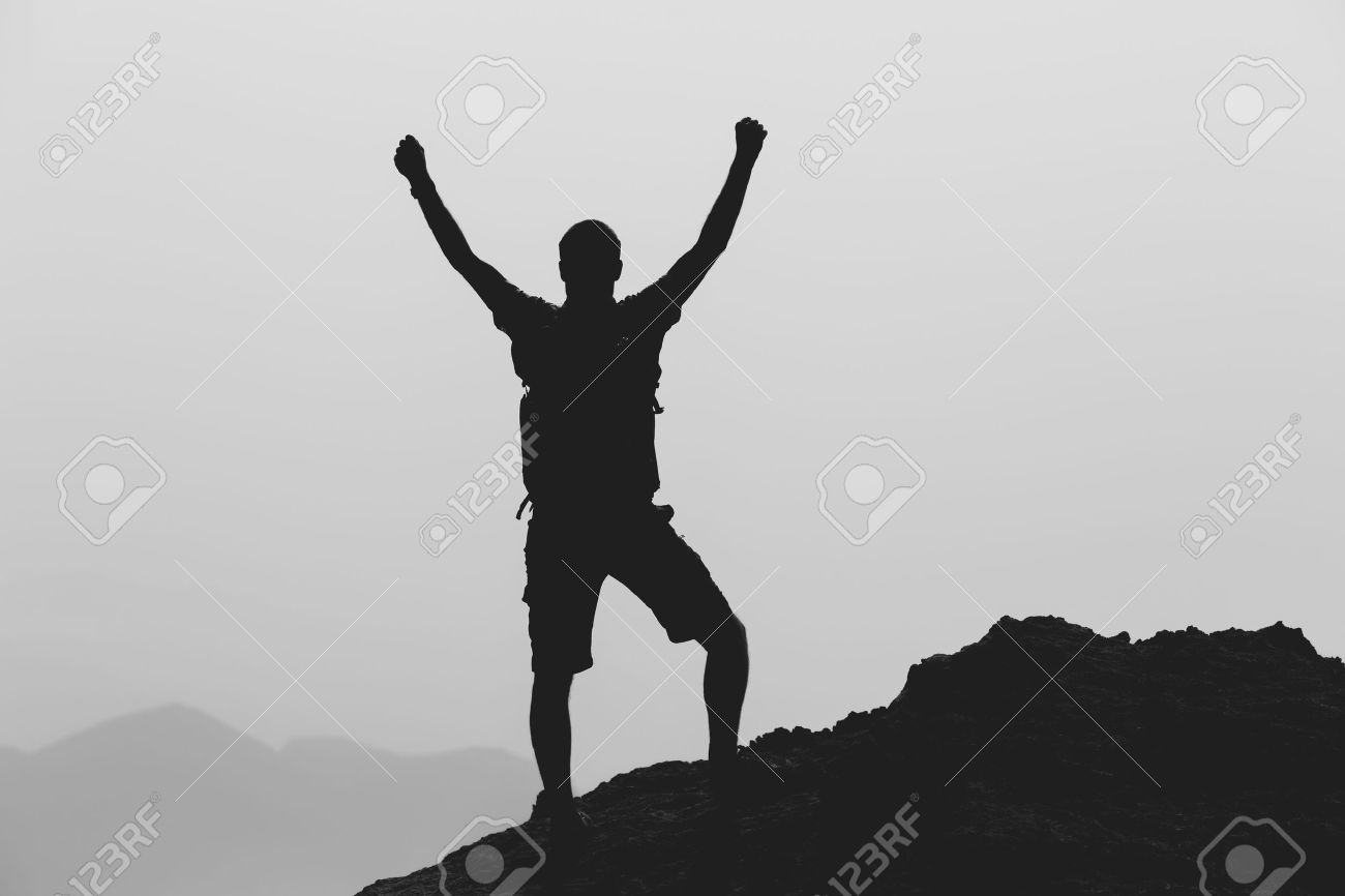 success achievement climbing or hiking accomplishment business stock photo success achievement climbing or hiking accomplishment business concept man celebrating arms up raised outstretched climbing