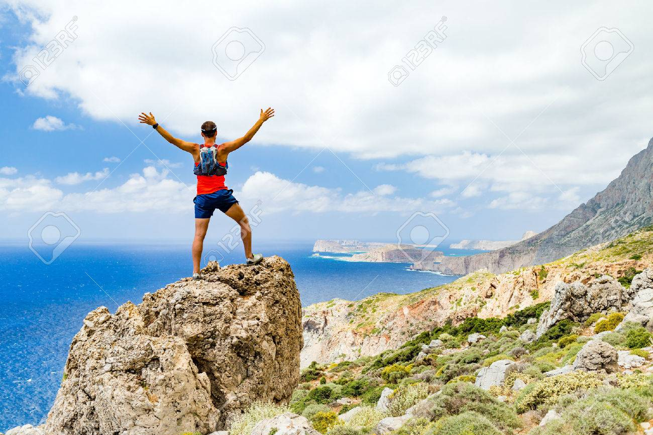 success achievement running or hiking accomplishment or business stock photo success achievement running or hiking accomplishment or business concept man celebrating arms up raised outstretched trekking climbing