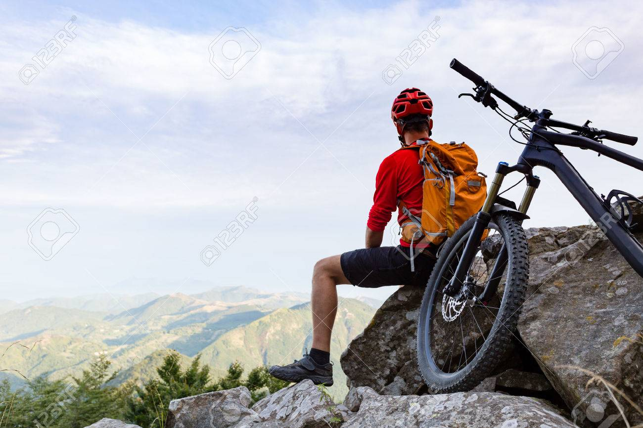 Mountain biker looking at view on bike trail in autumn mountains. Rider cycling on single track. Sport fitness, motivation and inspiration in beautiful inspirational landscape. - 56697774