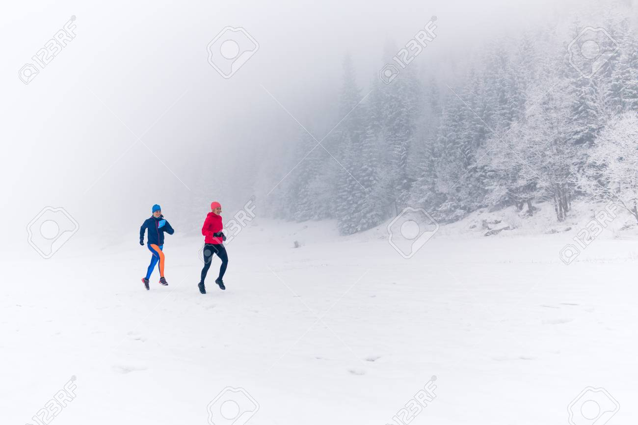 Girls Running Together On Snow In Winter Mountains. Sport, Fitness.. Stock  Photo, Picture And Royalty Free Image. Image 94158816.