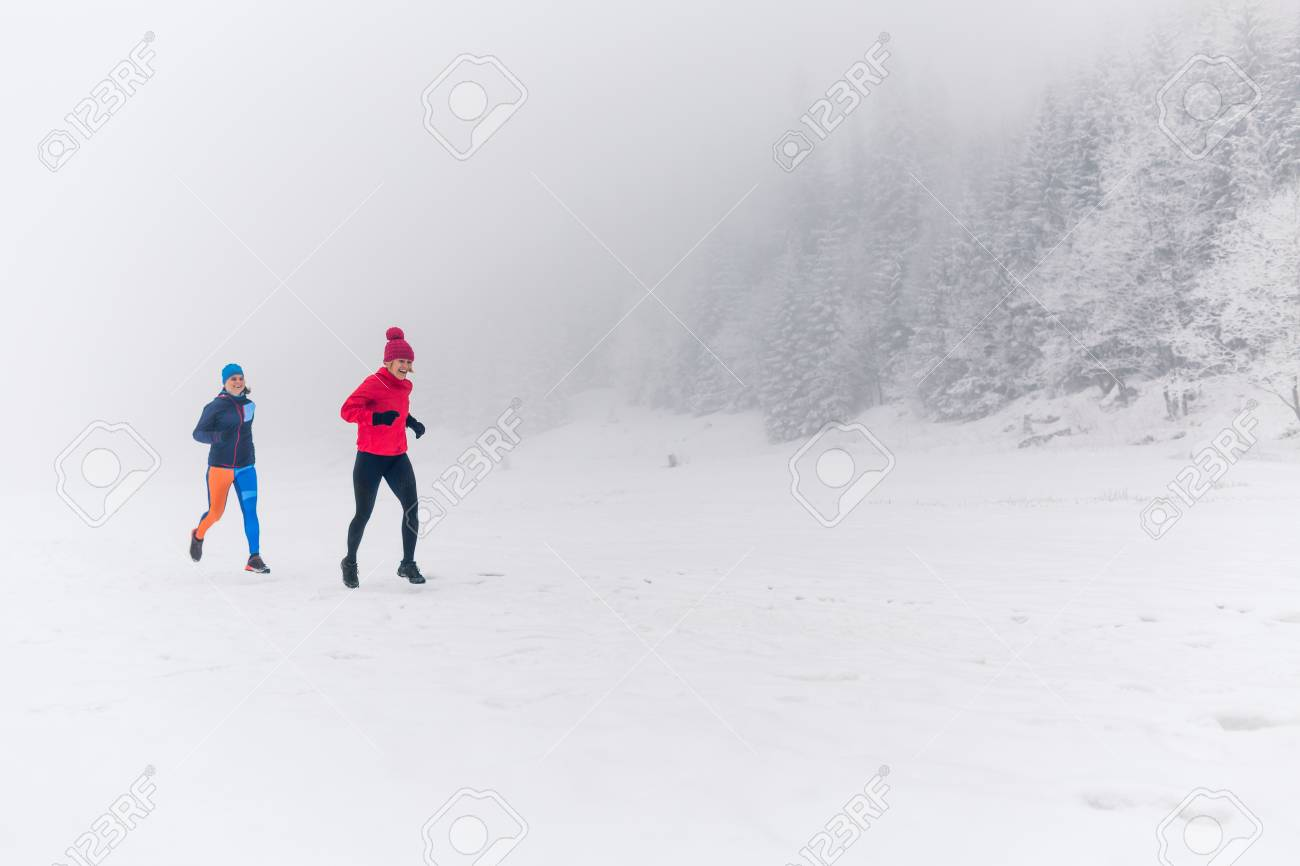 Girls Running Together On Snow In Winter Mountains. Sport, Fitness.. Stock  Photo, Picture And Royalty Free Image. Image 112710334.