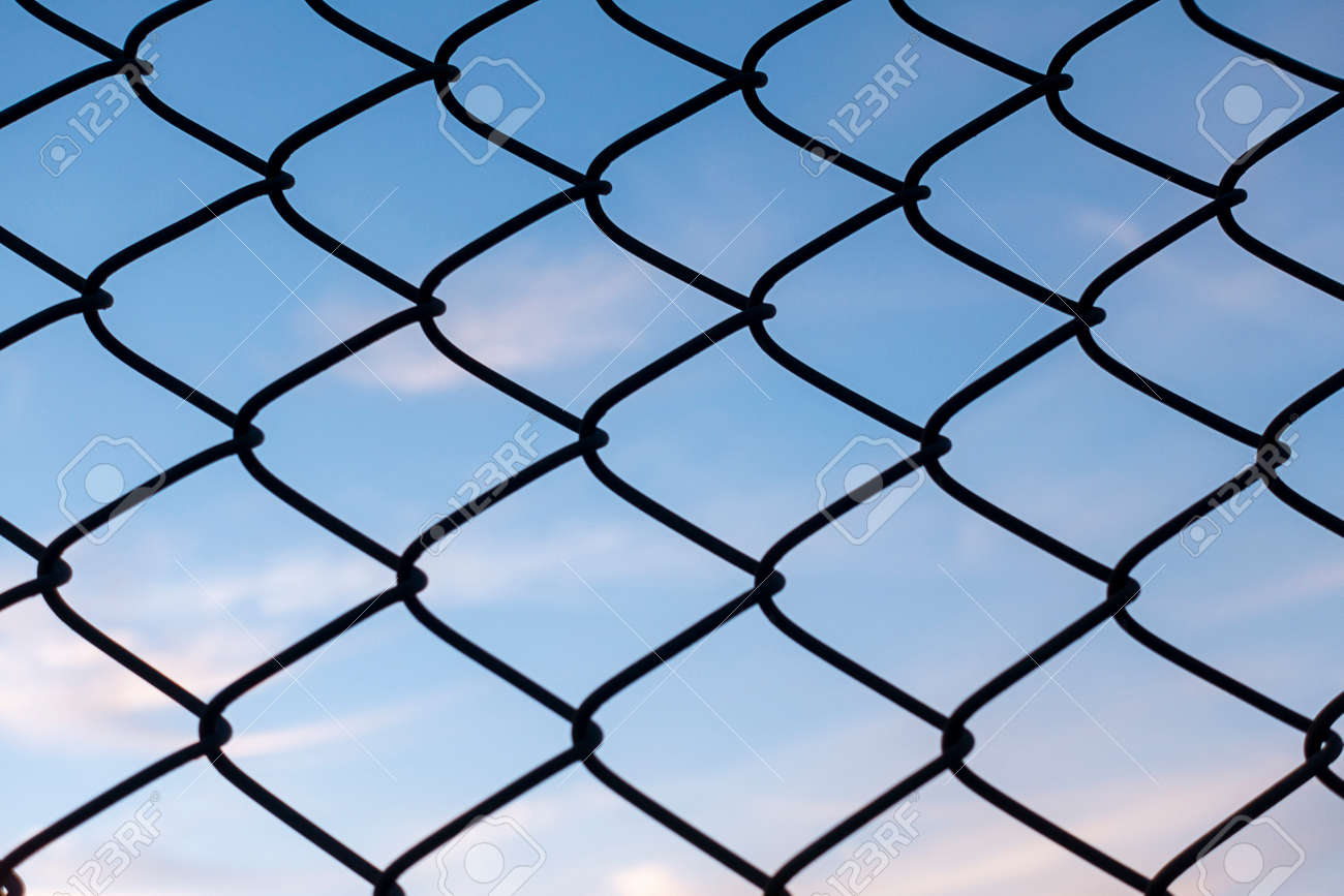 blue sky and wire fences - 164569611