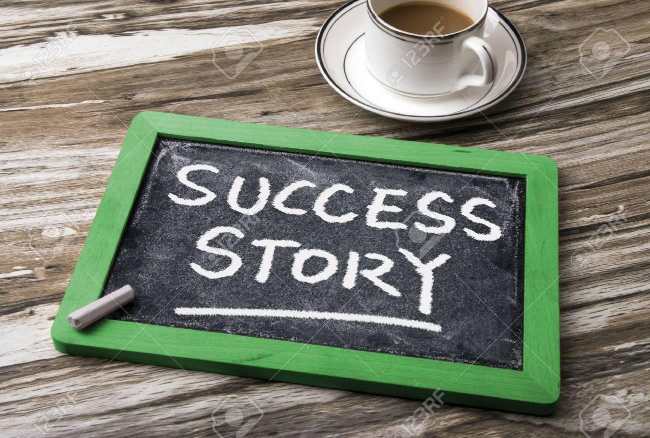 success story handwritten on blackboard Stock Photo - 42606390