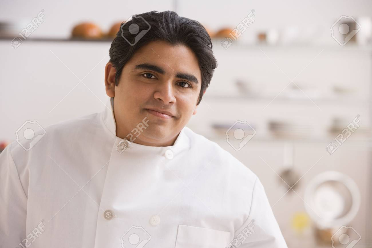 Hispanic Male Baker In Kitchen Stock Photo, Picture And Royalty Free ...