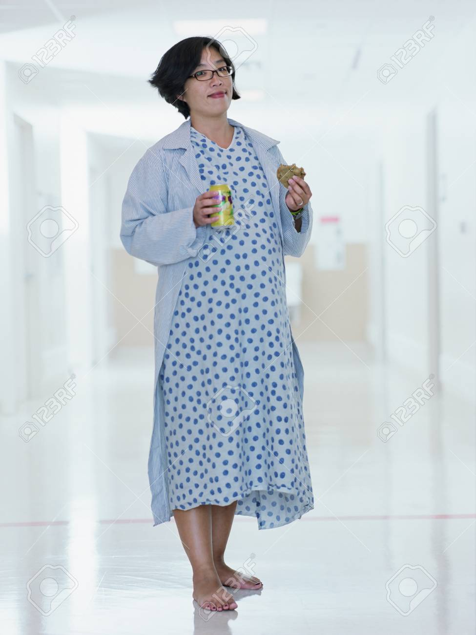 Pregnant Asian Woman In Hospital Gown Stock Photo, Picture And ...