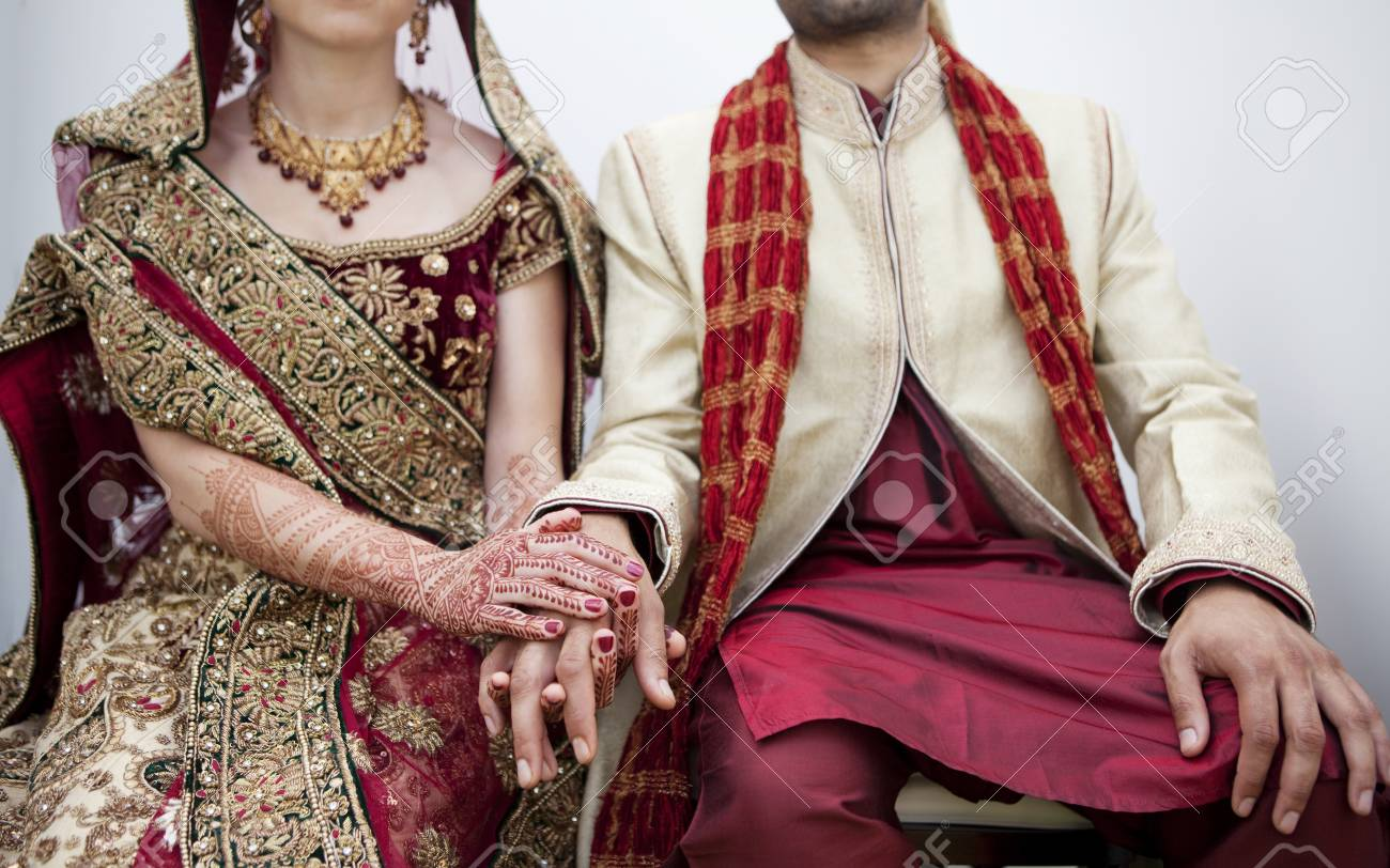 Bride And Groom In Traditional Indian Wedding Clothing Stock Photo ...