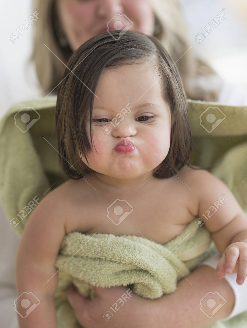 Hispanic Toddler Making Faces After Bath Stock Photo, Picture And ...