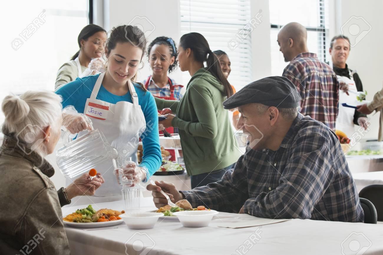 Stock Photo   Volunteer Serving Food At Community Kitchen