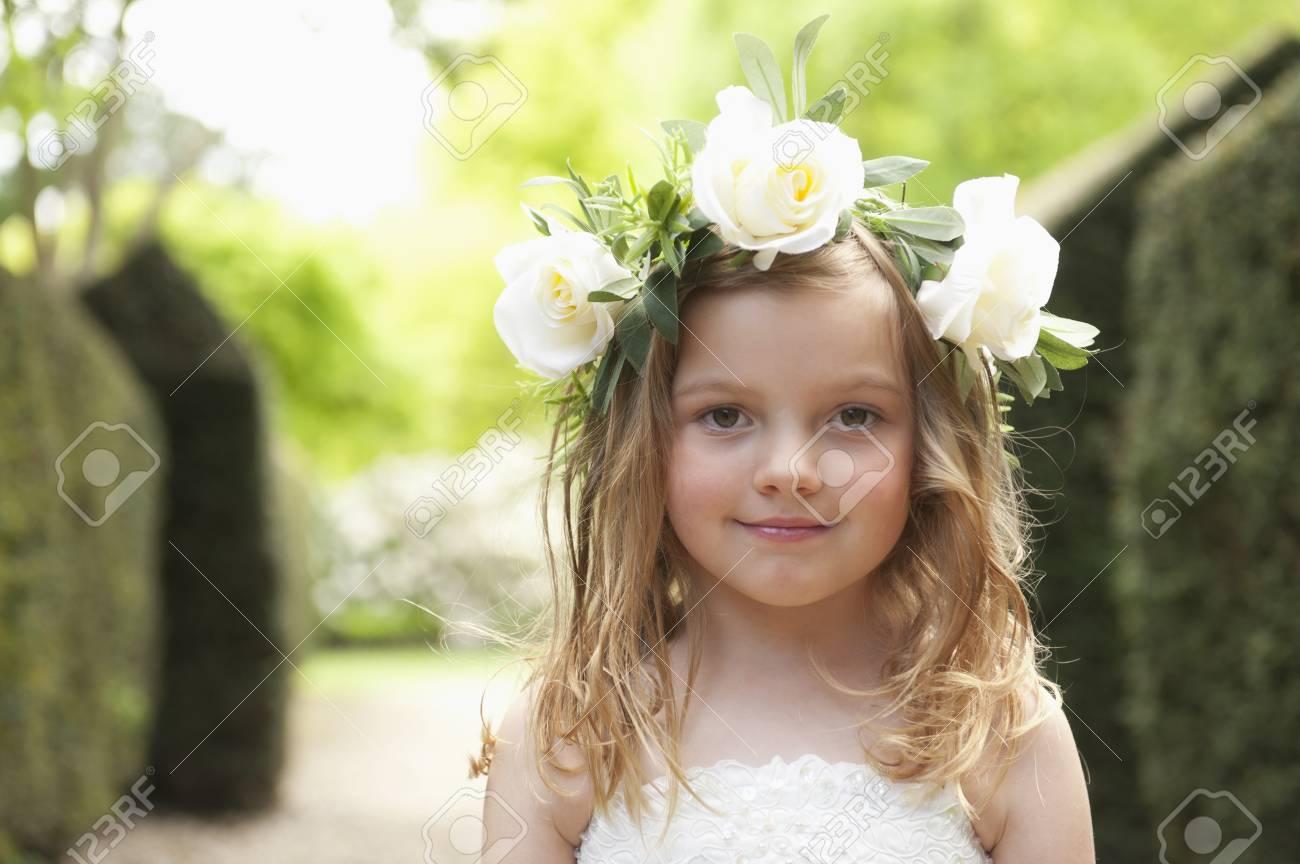 Caucasian flower girl wearing flower crown in garden stock photo caucasian flower girl wearing flower crown in garden stock photo 93899204 izmirmasajfo
