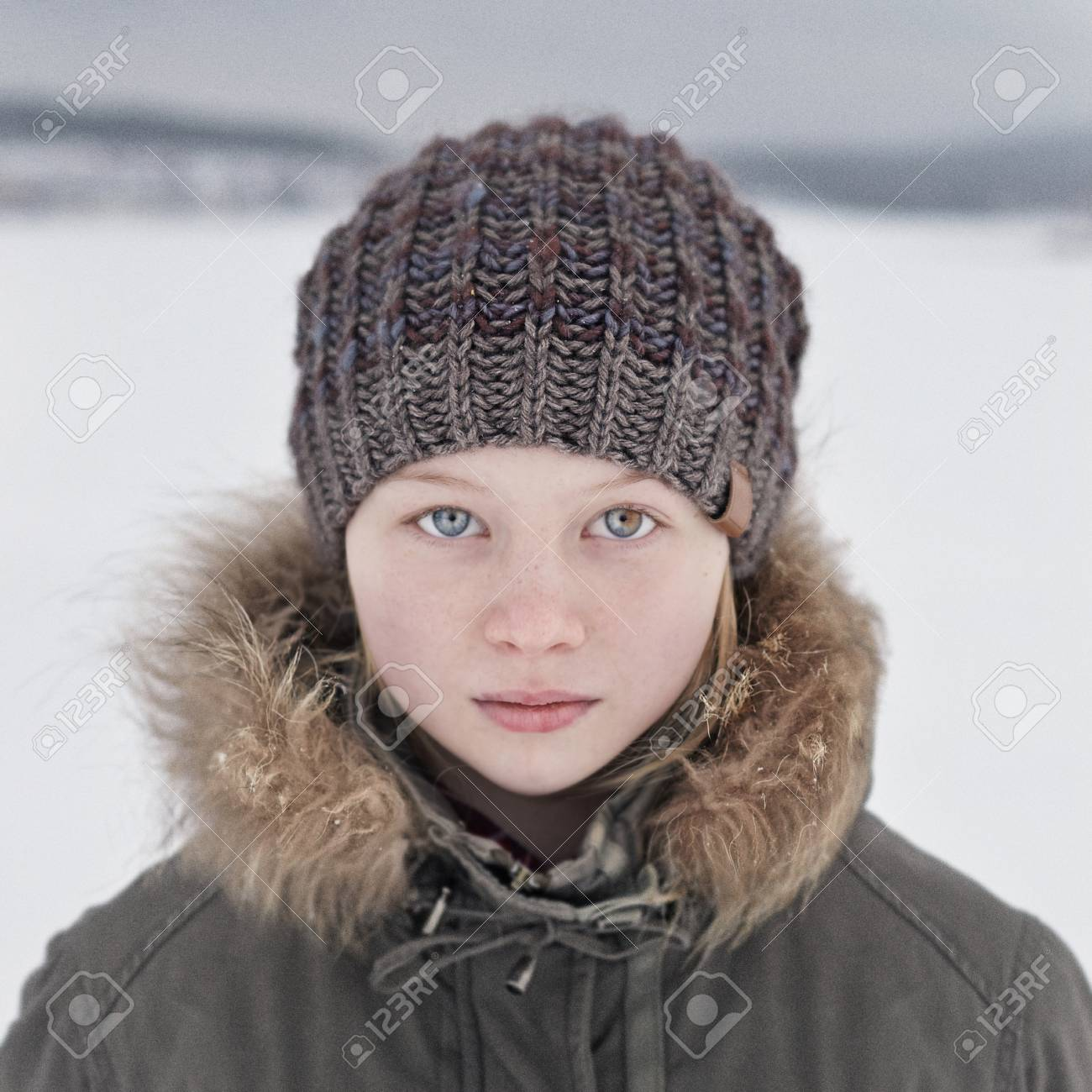 Caucasian teenage girl wearing beanie hat in snow Stock Photo - 95494345 fde9e2dca9e