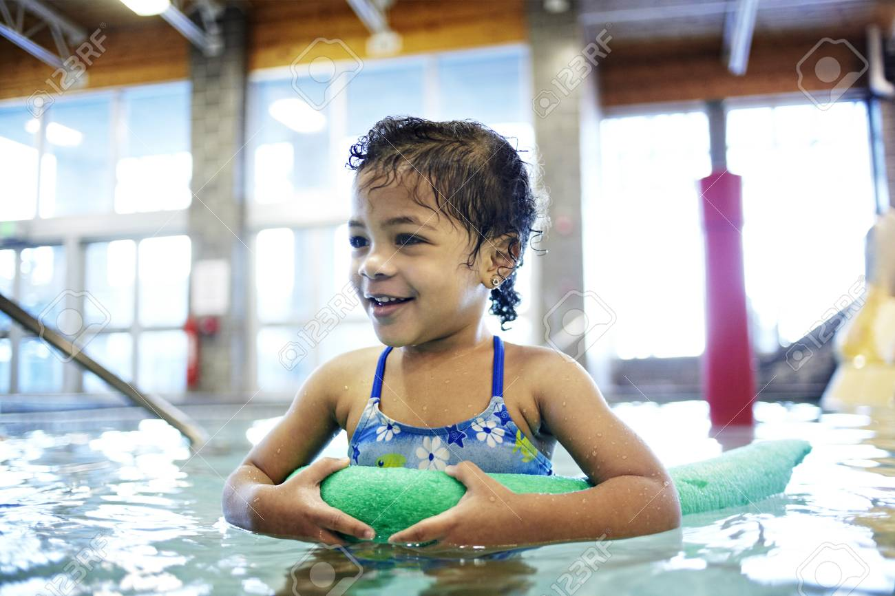 22bf821d2ac Mixed race girl using floater in swimming pool Stock Photo - 97165807