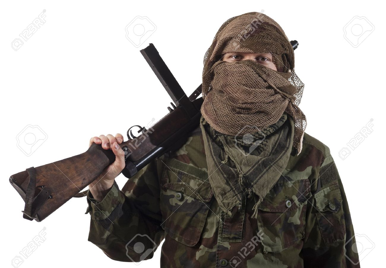 Camouflaged guerrilla soldier with hidden face and a machine gun Stock Photo - 10118195