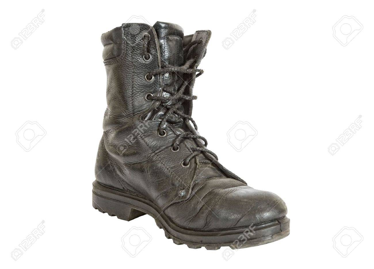 Old black army boots on white background - 6593516