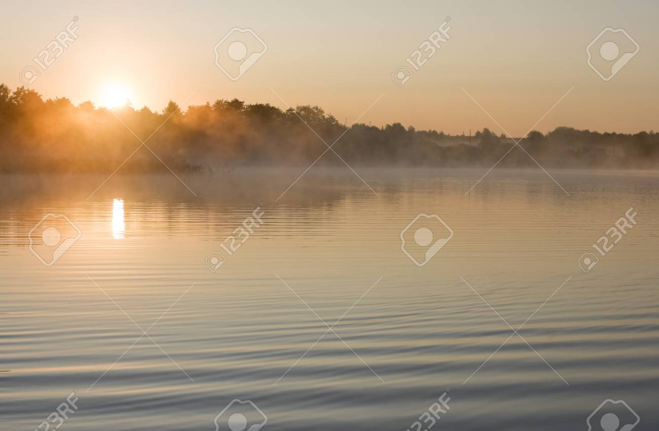 Sunrise over the water Stock Photo - 9342552
