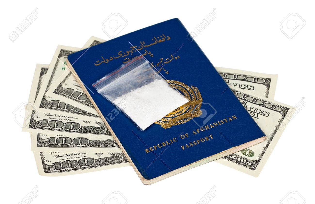 Package with drug over the Afghan passport and U.S. dollars Stock Photo - 11788443