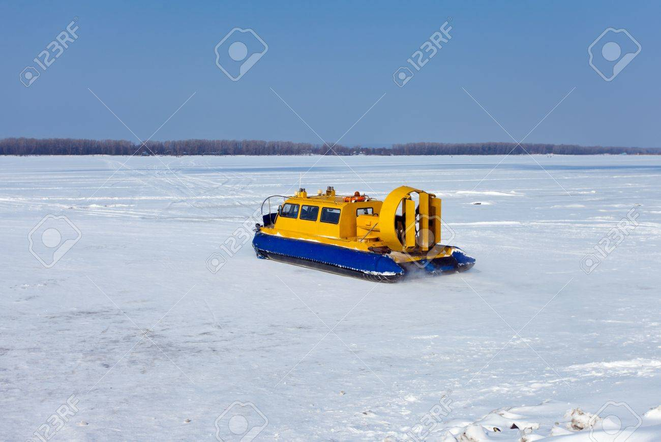 Hovercraft on the bank of a frozen river Stock Photo - 12830559