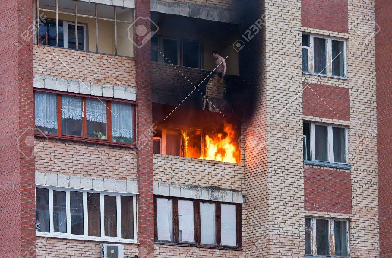 Fire in one of the apartments of a large tenement-house - 13096903